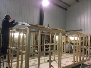 Hut frame being built